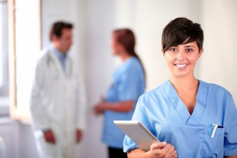 Lovely_latin_nurse_on_blue_uniform_standing.jpg